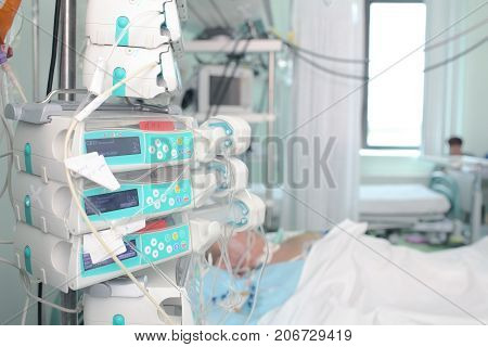 Patient in intensive care unit. Medical treatment in hospital