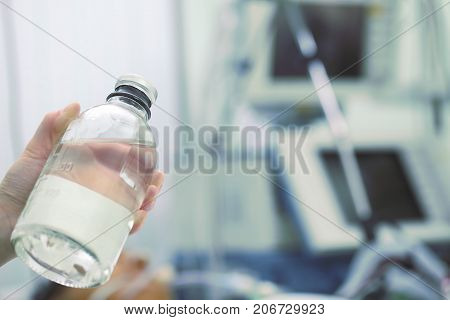 Doctor shows a bottle with a solution.