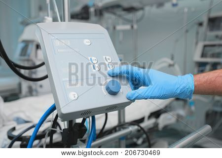Doctor setting the device in ICU room