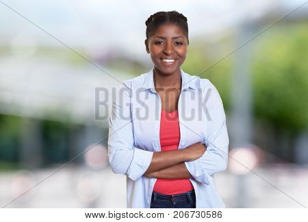 Joyful laughing african american woman with casual clothes outdoors
