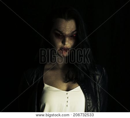 Spooky vampire woman smiling, mouth of woman in blood