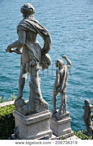 Statues gazing at the lake in the gardens of Isola Bella in Lago Maggiore Italy