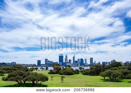 The Perth city skyline viewed across Sir Jame Mitchell Park in South Perth, Western Australia.