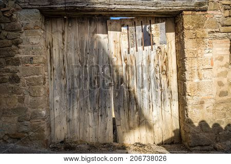 vintage door of external antique wooden door weathered on a Country barnyard