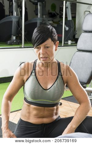Muscular Pixie-haired Brunette Fitness Trainer In Gym