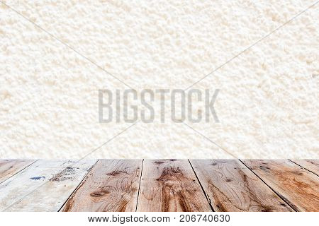 White Wall And Brown Wooden Floor