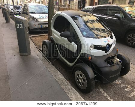 Villeurbanne France, 1 October 2017: Bluely electric car sharing Renault Twizy plugged in the street in Grand Lyon