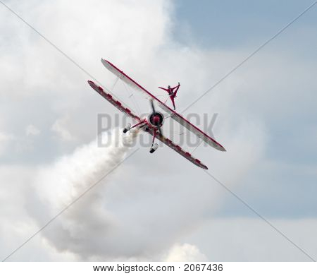 Acrobat On Airplane