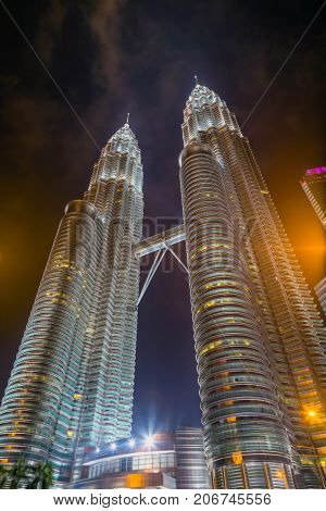 KUALA LUMPUR - FEBRUARY 19: The Petronas Twin Towers as seen from the ground on February 19 2015 in Kuala Lumpur Malaysia are the world's tallest twin tower.