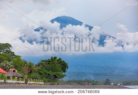 Bali. Beautiful Nature landscape with views of the volcano Agung in Amed Indonesia. Volcano Agung it is the highest point of the island and is considered a sacred mountain among local residents.