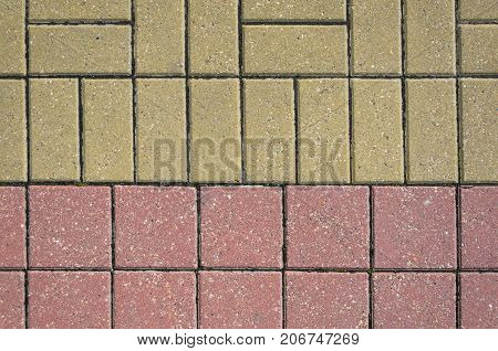 Two Color Pavement Cover Texture. Joint of Curb Stones of Two Different Color and Shape