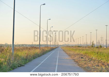 Bike path at autumn evening on outskirts of St.Petersburg, Russia.