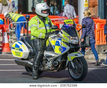 Dublin, Ireland - 30 September 2017: Garda - Irish police officers on the motorcycle, patrolling Dublin streets during March for Choice in Dublin city centre
