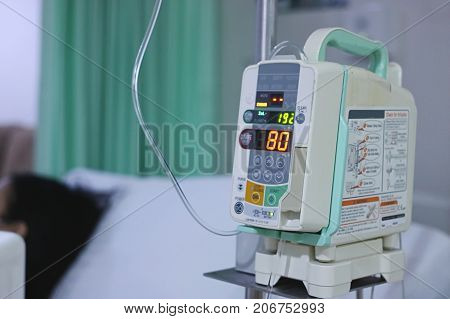 Infusion pump intravenous IV drip in the hospital with copy space background.
