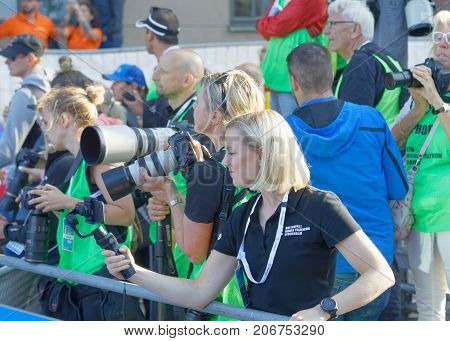 STOCKHOLM - AUG 26 2017: Professional photografers taking photos the finish of the triathlon race in the Men's ITU World Triathlon series event August 26 2017 in Stockholm Sweden