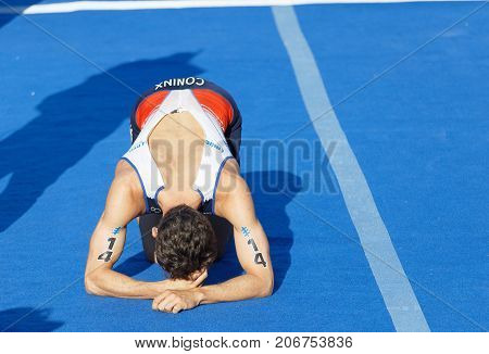 STOCKHOLM - AUG 26 2017: French triathlete Dorian Coninx (FRA) laying down exhausted after the race in the Men's ITU World Triathlon series event August 26 2017 in Stockholm Sweden