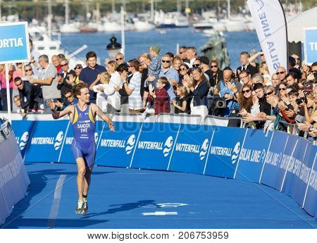 STOCKHOLM - AUG 26 2017: Running triathlete Gabriel Sandor (SWE) close to the finish line audience in the background in the Men's ITU World Triathlon series event August 26 2017 in Stockholm Sweden