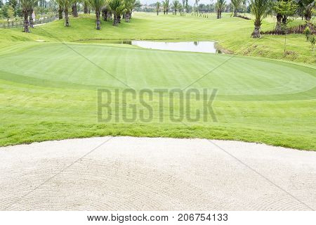 Golf courses , fine green grass and  sand strap