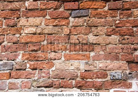 Antic brick texture on the wall of an old Turaida castle in Latvia. Architecture background