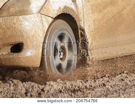 car increase speed on muddy road .