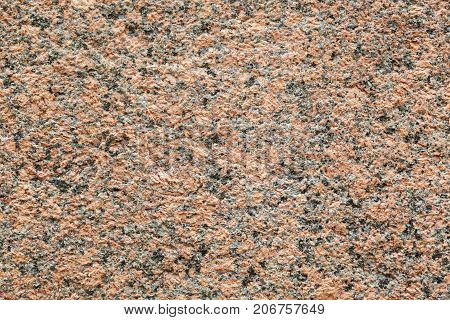 Natural stone red granite texture background. Bright hard red granite texture. Red granite texture stone background. Red granite texture untreated surface. Facing material horizontal background.
