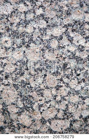 Natural stone granite texture background. Facing material horizontal background.