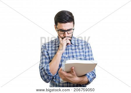 Handsome bearded young man in glasses hold textbook
