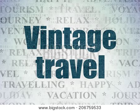 Vacation concept: Painted blue text Vintage Travel on Digital Data Paper background with   Tag Cloud