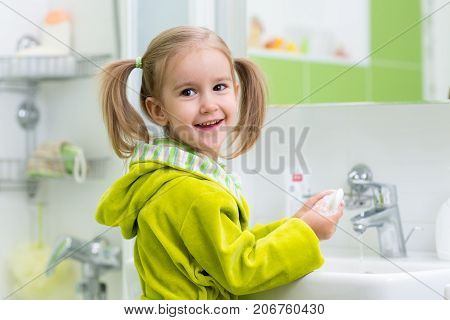 Child washing her hands protecting from germs