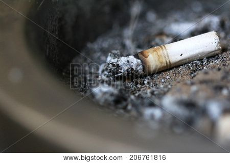 Cigarette Stub in Ashtray Close up Smoker Abstract