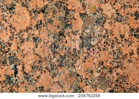 Natural stone red granite texture background. Facing material horizontal background.