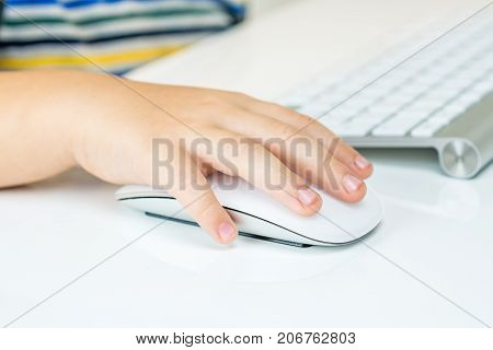 Young Boy Is Working With Computer Mouse