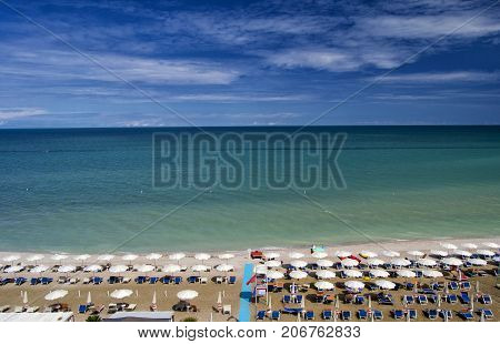 aerial view of parasols and beachline in Marotta. For travel and holiday concepts