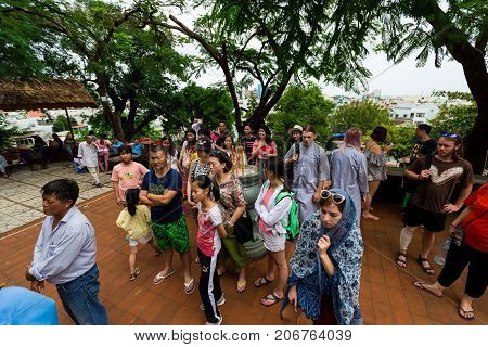 NHA TRANG, VIETNAM - SEPTEMBER 25, 2017: Pilgrims praying near the temple of Po Nagar Cham Towers. Women praying in crowd of tourists. Sight, Landmarks