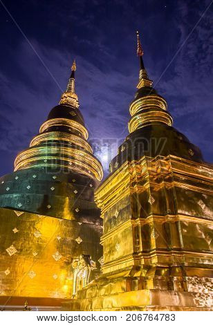 The golden pagodas shines in the moonlight