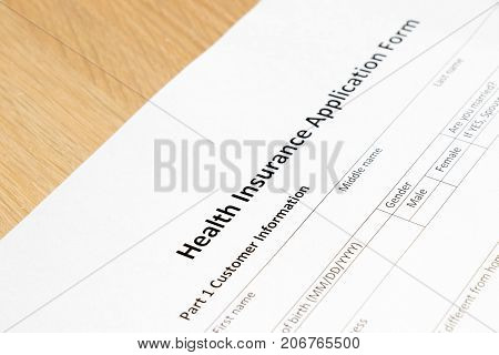 Health insurance application form wait to fill information on desk background