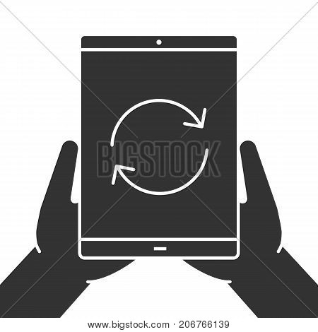 Hands holding tablet computer glyph icon. Device synchronization. Silhouette symbol. Tablet computer with cycling arrows. Negative space. Vector isolated illustration