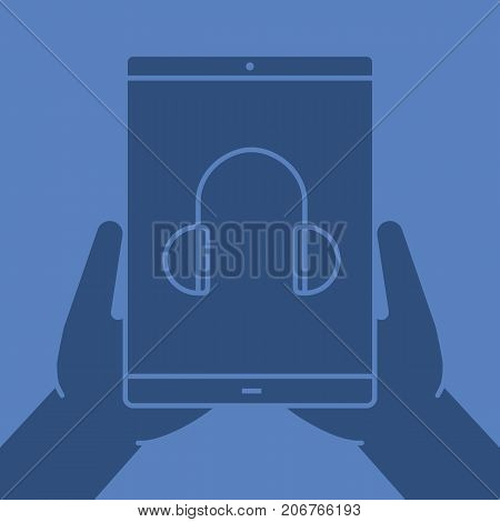 Hands holding tablet computer glyph color icon. Listen to music. Silhouette symbol. Tablet computer with headphones. Negative space. Vector isolated illustration