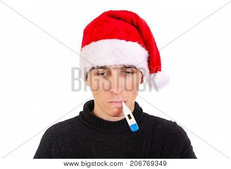 Young Man in Santa Hat and Thermometer on the White Background