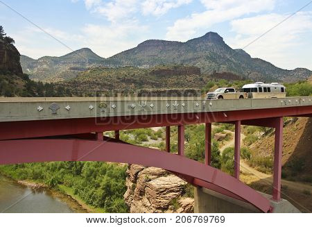 GILA COUNTY, ARIZONA, JUNE 24. Salt River Canyon Bridge on June 24, 2017, in Gila County, Arizona. A Pickup Truck Pulls a Travel Trailer Across the Salt River Canyon Bridge in Gila County in Arizona