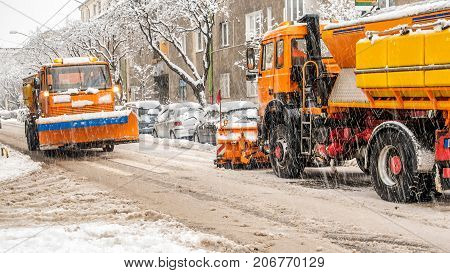 snow plough making shovelling roads during strong winter storm