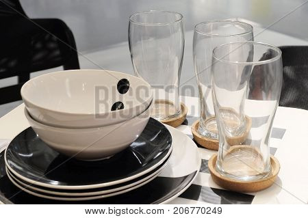 Kitchen Utensil Set of Porcelain Plates with Bowls and Glass Preparing for Serve Hot and Cold Food on The Table.