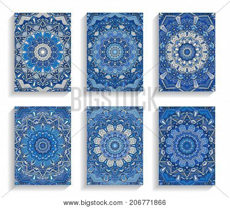 Blue Cards for Happy New Year or Christmas Greetings. 5 to 7 ratio. Intricate mandala round ornament. Luxury flourish pattern. Floral invitations set. Vector illustration.