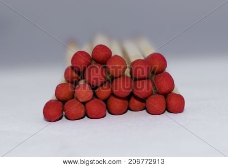matchstick isolated on white background wooden red group heap design