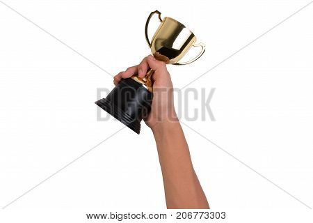 Asian boy holding a gold trophy cup for first place chanpion award isolated on white background. Boy holding up a gold trophy cup as a winner in school competition.
