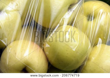 close up of Yellow Golden Apples packed in plastic film