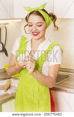 Pretty Young Housewife Cooking Dough In The Kitchen