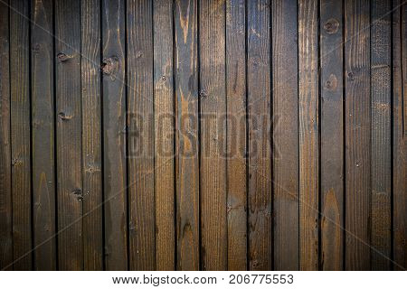 closeup of an brown wooden fence with vignetting