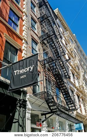 New York September 25 2017: Theory Men banner flies near the entrance to their boutique store in SoHo.