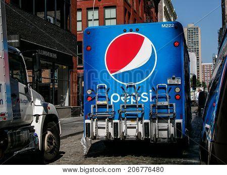 New York September 25 2017: Pepsi truck is navigating a street in SoHo.